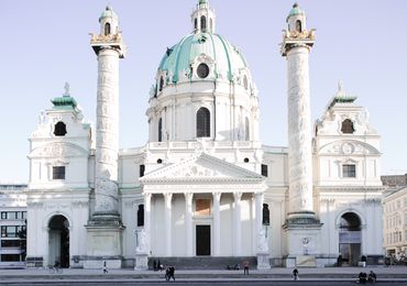 The iconic St. Charles Church is a prominent neighbot of TU Wien's main building.