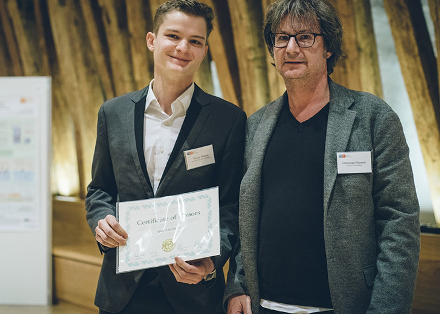 Timon and Dean of Studies, Christian Huemer, at the 28th Epilog receiving his certificate.
